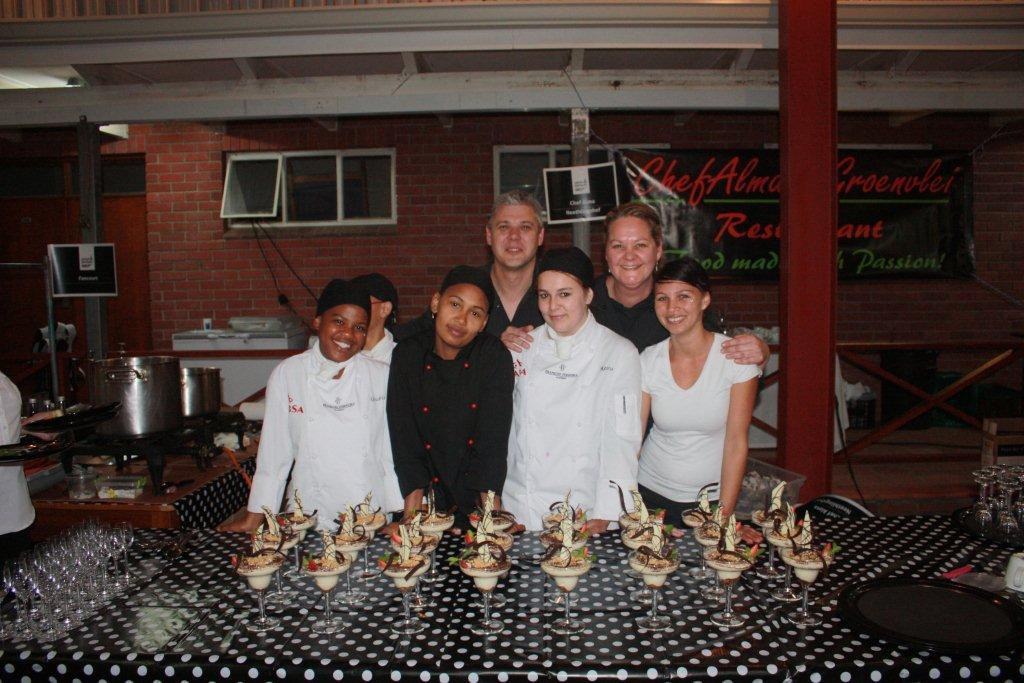 Chef Alma  her cooking team at the 2013 Gourmets  Gourmands supported by Hartmans
